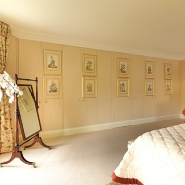 Master bedroom silk fabric covered wardrobes and walls