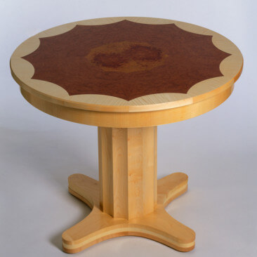 Intricate veneered table in ripple sycamore banding, pommele douka & thuya burr at the heart